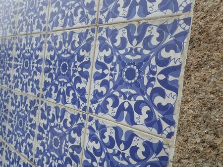 blue and white tiles with curves on wall