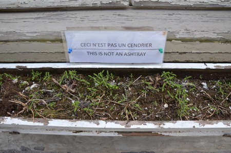 this is not an ashtray sign in french and english and flower box