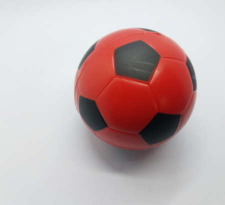 red and black soccer ball on white background Imagens