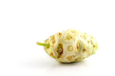 Noni Fruit isolated on white background.Noni Leaves the hair with a lice removal of York asperuloside to relieve nausea and vomiting. Stock Photo