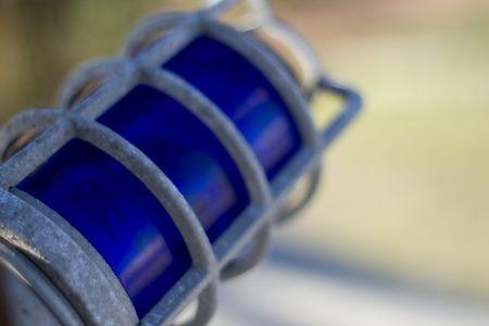 A blue warning light, unlit.