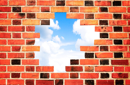 foundation cracks: brick wall with hole Stock Photo
