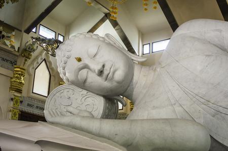 nirvana: The biggest white marble nirvana buddha at Wat Pa Phu Kon, Udon Thani Thailand Editorial