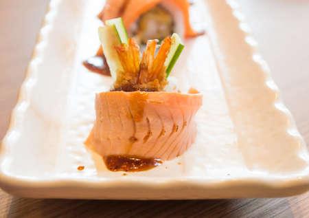 philadelphia roll: Raw fresh Salmon sushi roll maki - japanese food-7