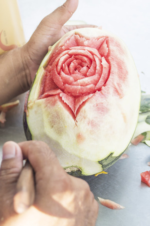 man s: Man s hands carved watermelon show step