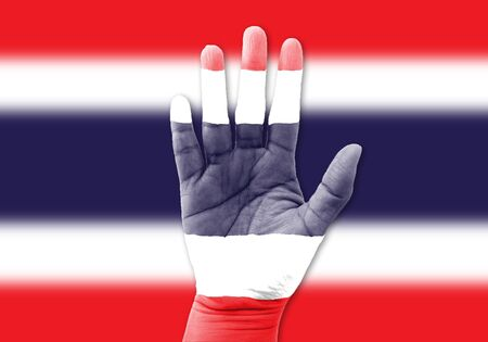 thai flag: woman hands, wrapped in flag pattern,Thailand Stock Photo