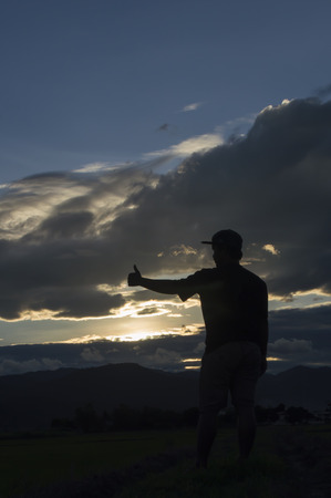 man standing alone: man standing alone at the mountain during beautiful sunset