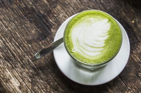 Matcha Latte , Green Tea, on Wooden Background table. Stock Photo