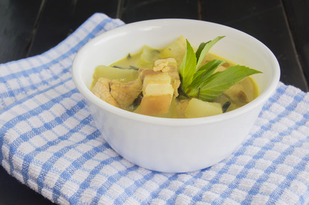 long bean: Green pork curry with old wooden background , Thai cuisine