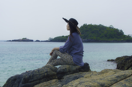Asian beautiful girl smilling on the beach vacation enjoying.
