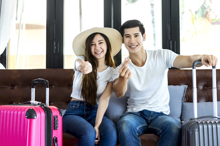 flip flops: Happiness Asian couple traveler packing suitcases preparing for travel vacation together.Happy enjoy to smiling at home in the living room.Travel concept .