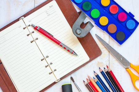 assignments: Top view of education and business supplies on white wooden table,Education concepe.Copy space. Stock Photo