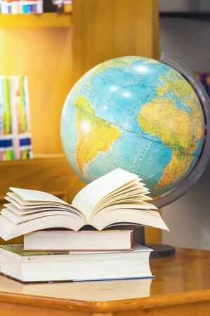 Book and glasses with map of the globe in the library,Education concept. Stock Photo