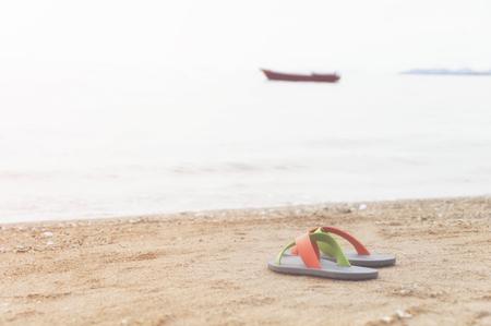Flip flop on the beach, select focus