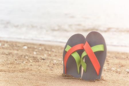 Flip flop on the beach, select focus