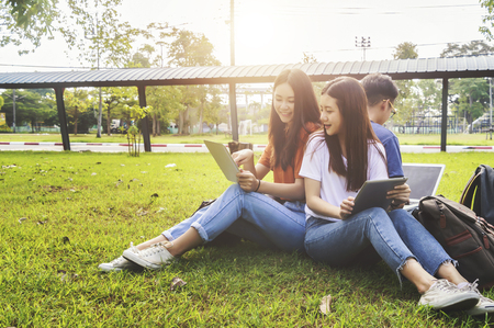 Asian group education, campus, friendship and people concept group of happy teenage students with school folders. 免版税图像