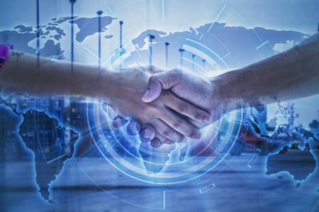 Two business man handshaking for Logistic and transport concept in front Industrial Container Cargo freight ship for Concept of fast or instant shipping,World map with logistic on background. Stock Photo