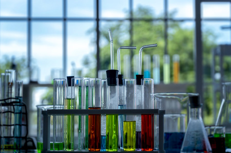 Colorful laboratory research, dropping liquid to test tubes,science laboratory research and development concept. 스톡 콘텐츠