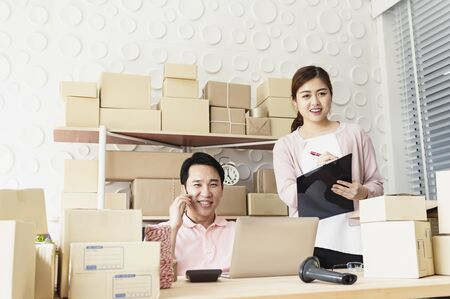 Young business couples startup family business, online marketing packaging and delivery scene. SME entrepreneur, Freelance work at home concep