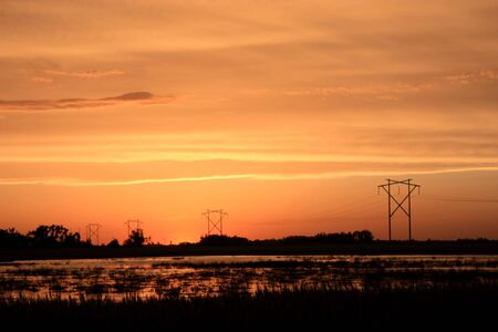 A Sunset with poles and power lines Stock Photo - 5065855