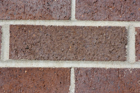 Red bricks closeup with cement in between holding them together. Banco de Imagens