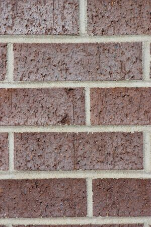 A red brick wall closeup with cement seams. Stock Photo - 9349512