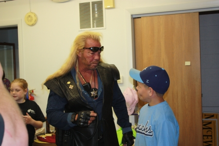 chapman: BIG DOG Duane Chapman talking to a group of kids when he was in Hutchinson Kansas at Barbs Bail Bonds. With his sun glasses on his fore head.