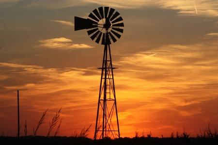 Kansas Orange sky with a windmill silhouette Banco de Imagens - 20750927