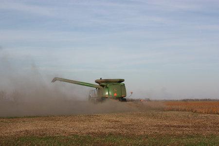 john deere: John Deere combine cutting wheat.