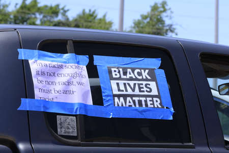 A shot of a sign on a black Vehicle at the George Floyd Protest. Across from the Reno Country Court House that say's BLACK LIVES MATTER. Stock Photo
