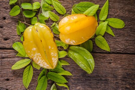yellow star fruit or star apple on wood background