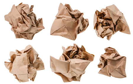 Brown paper crumpled into a ball. Stock Photo