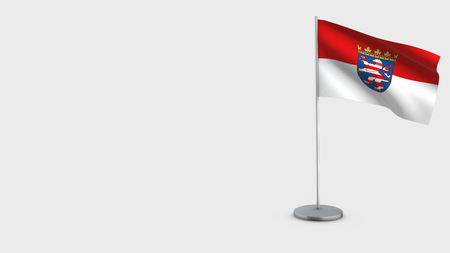 Hesse 3D Flag isolated on white background. Waving in wind on steel flagpole. Imagens