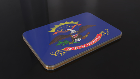 North Dakota 3D glossy flag object isolated on black background. Imagens