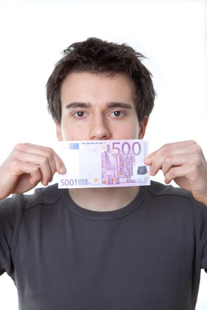 Young man with a 500 euro banknote on his mouth isolated against white background photo