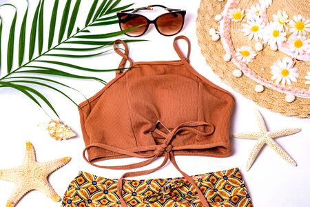 Accessories for summer Fashion woman swimsuit bikini outfit to essentials travel tropical sea top view copy space