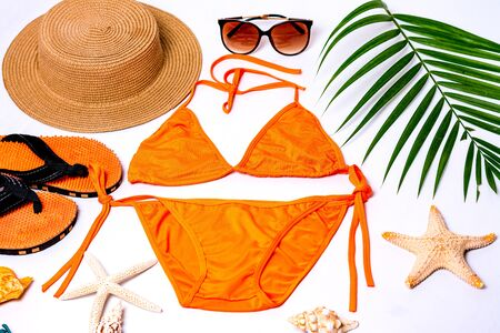 Accessories for summer Fashion woman swimsuit bikini outfit to essentials travel tropical sea top view copy space Vacation concept