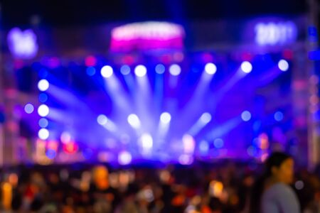 Bright laser light concert background large group of people enjoying party having fun in active night life music star performance