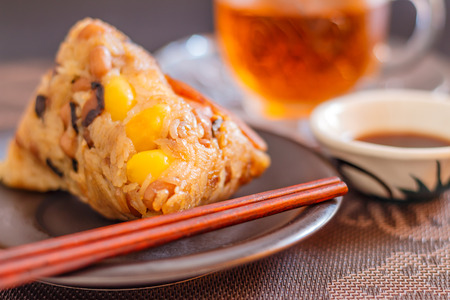 Zongzi or Asian Chinese rice dumplings is a traditional Chinese food eaten during the dragon boat festival.