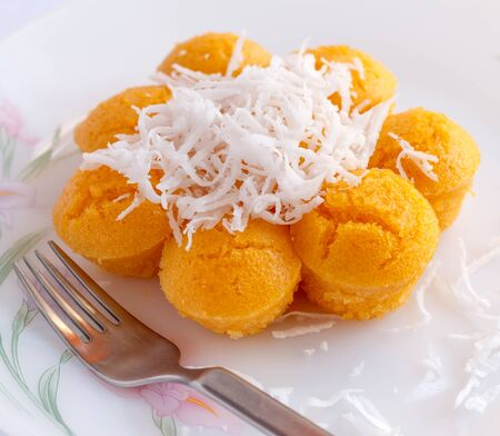 toddy palm: Toddy palm cake topped with coconut.