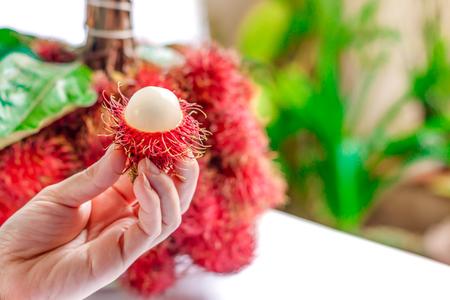hands off: Rambutan peels off half In the womens hands