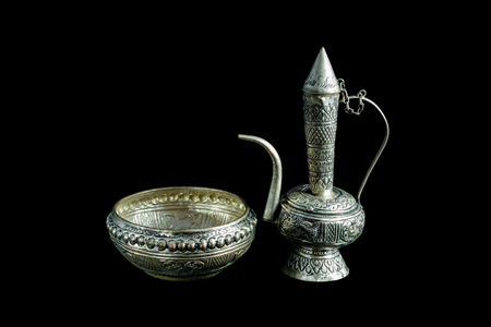 ewer: Old silver ewer container pour water, Buddhism on black background.