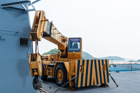 shove: Crash Crane used to push or shove aircraft rooftop overboard. The uncontrolled fire On the aircraft carrier HTMS Chakri Naruebet. Editorial