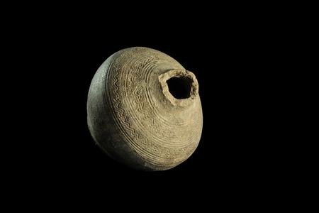 antique vase: Antique primitive vintage vase with isolated on black background. Horizontal image.