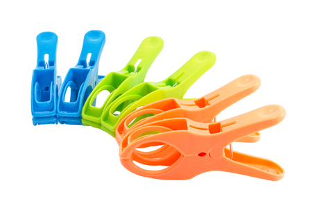 c clamp: Closeup of three plastic spring clamps (Blue, Green, Orange) isolated over white background.