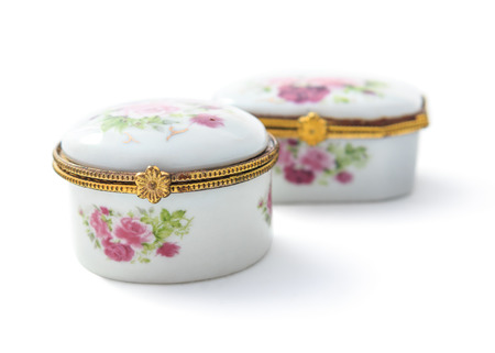 jewel case: Vintage small ceramic jewelry box or porcelain China Mainland made of ceramic perfect design and realism with isolated on white background. Stock Photo