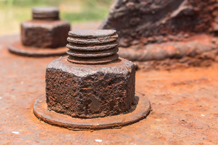 corrosion: Old rusty metal nuts locked with rust and corrosion old bolts. Close up. Stock Photo