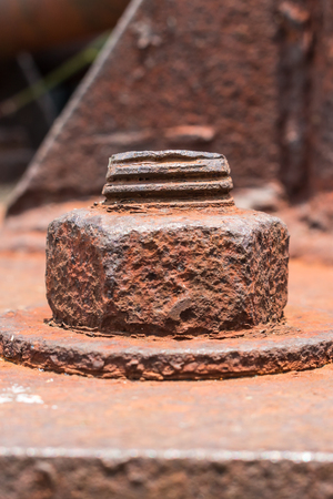 metal corrosion: Old rusty metal nut locked with rust and corrosion old bolts. Close up. Stock Photo