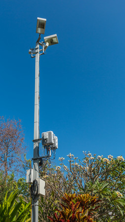 Lamp with wireless network on blue sky background.