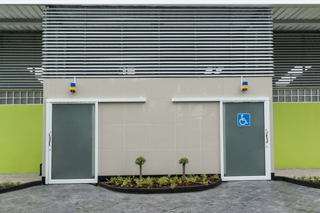public toilet: Photo of modern toilet for disabled people.  - Outdoor public toilet  with sign for disabled people.